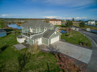 Peaceful waterfront home in desirable gated community.