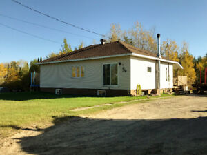 Bungalow with garage on a 1/2 acre lot.