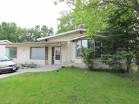 3 Income Home in Steinbach- Oversized back yard