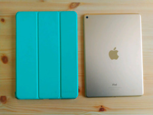Gold 64gb iPad Air II with teal protector case