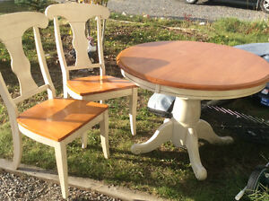 Solid wood kitchen table with two chairs