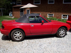 1990 red Mazda MX-5 Miata Convertible