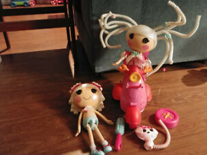 Lalaloopsie Dolls ( 2 )and motered bycicle.. With remote.