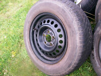ONE GOOD SPARE 14 INCH TIRE AND RIM FOR CAVALIER