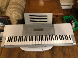 Casio WK-225 Touch sensitive keyboard and X Stand