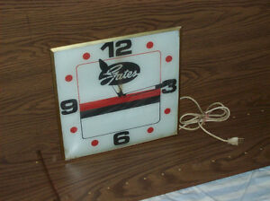 Antique advertising clock