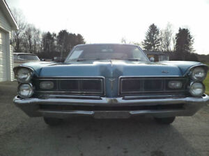 1965 Pontiac Grand Prix 389. Just being finished.