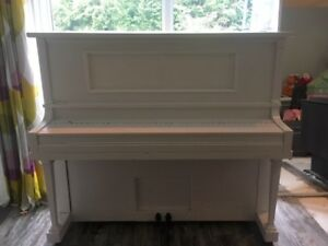 Piano - painted white but wood under