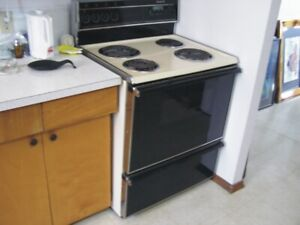 Range with self-cleaning oven.