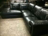Black corner sofa in genuine leather