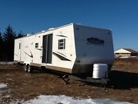 PRICE DROP!! Conquest travel/Park trailer 39' with 2 tip outs.