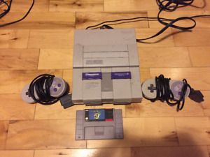 Super Nintendo with two controllers and Mario World