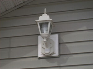 Exterior light with photo cell and motion detector
