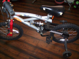 KIDS BIKE WITH TRAINING WHEELS IN EXCELLENT CONDITION