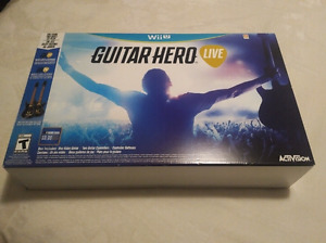 Guitar Hero Live game for Nintendo Wii U with two guitars