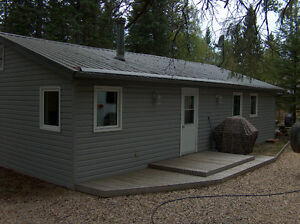 PRICE REDUCED TO SELL.  Lakefront 4 season cottage in Sask.