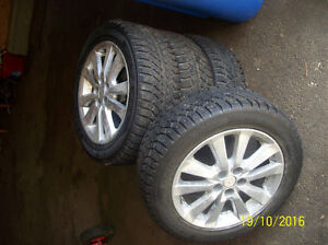 four studded snow tires on alloy wheels