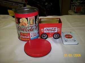 Two Coca-Cola tins