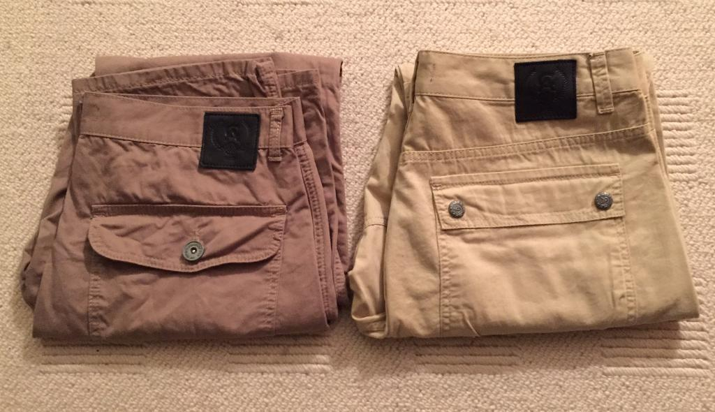 Two pairs of brand new men's Christian Audigier waist 34 leg 32 chino trousers. Authentic