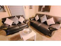 DFS Chunky Black leather 3 seater and 2 seater sofas amazing comfort stylish and modern