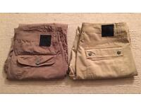 Two pairs of brand new men's Christian Audigier waist 34 leg 32 chino trousers