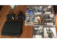 PlayStation 3 with games and two controllers