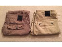 Two pairs of brand new men's Christian Audigier waist 34 leg 32 chino trousers. RRP £100 each
