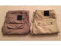 Two pairs of brand new men's Christian Audigier waist 34 leg 32 chino trousers. Authentic