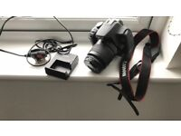 Canon 1200d, 18-55m lens, charger, battery and strap