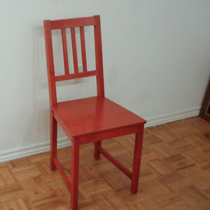 "Red Ikea ""Stefan"" chairs"