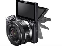 Sony NEX5T camera with 16-50mm lens and 2 flashes. Original box + manual, in very good condition