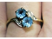 blue topaz and diamond ring, 9ct gold, 65pts.size P.fully hallmarked.(can post if required)