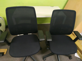 Selection of black office ergonomic chairs