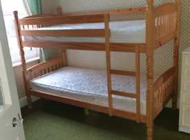 Pine bunk beds with mattresses