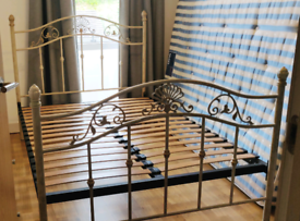 Cream metal frame bed (size: double)