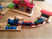 ELC wooden train set - station roof records/plays