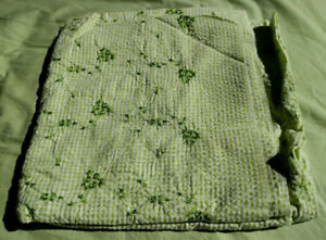 Green gingham fabric with green embroidered flowers