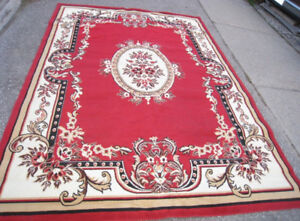 Slightly used clean Large 8' X 11' red Area Rug in good clean co