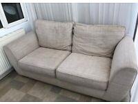Cream two seater sofa