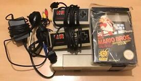 Nintendo Entertainment System. All leads, 2 controllers and Super Mario Bros.