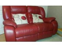 2 seater double reclining red leather sofa.