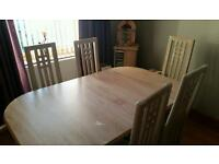 Limed oak extending table and 6 chairs