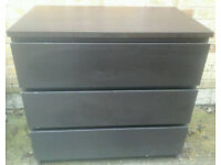One black chest of drawers