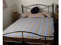 METAL DOUBLE BED WITH NEW MATERESS PLUS 2 WICKER SIDE TABLES AND 1 LAMP