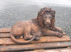 Large stone lion garden ornament