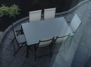 LIKE NEW MODERN GLASS TOP TABLE WITH 8 X RECLINER CHAIRS