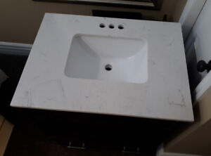 Vanity with stone top and under-mount sink