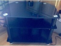 Black smoked glass tv stand with cable tidy at back
