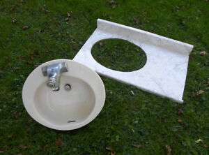 nice oval porcelain bathroom sink with faucet and counter top