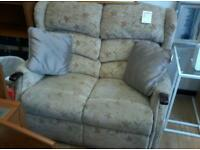 Floral 2 seater sofa.